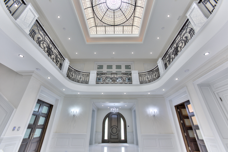 Hall with leaded glass dome skylight and white marble floors