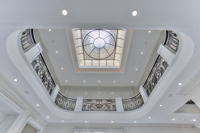 Stained and leaded glass dome skylight and white marble floors
