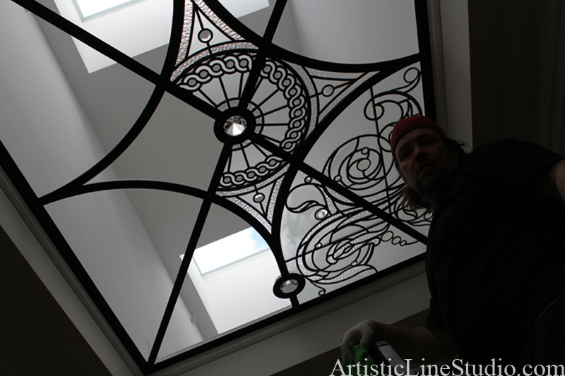 Stained and leaded glass flat skylight installation in progress