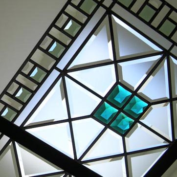 Stained and leaded glass skylight with custom beveled glass and emerald jewels in English manor style