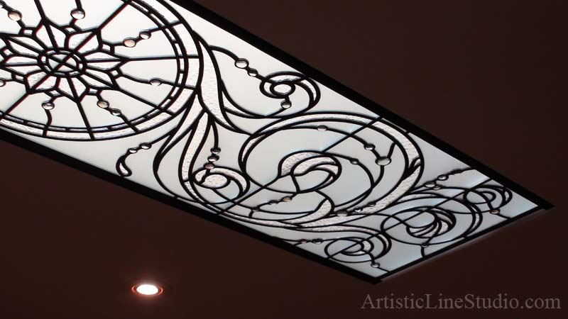 Leaded glass skylight ceiling with clear acid, granit glass and pale colored noggets as accents