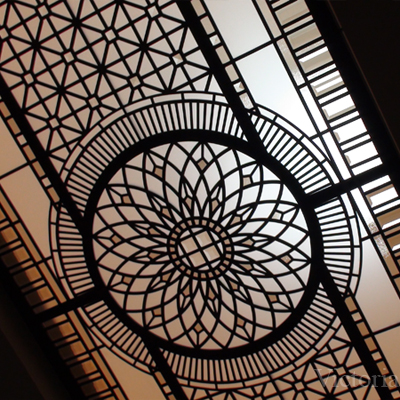 Elegant classic ornamental glass ceiling with clear textured glass and colored beveled glass