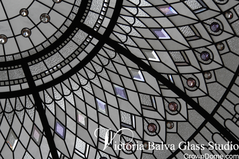 Colored custom made bevelled glass acanthus with crystal jewels for a large leaded glass dome