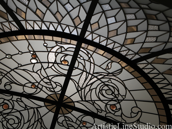 Large custom designed oval stained and leaded glass dome with jewels and clear textured glasses