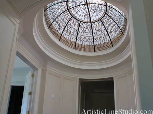 Large domed oval ceiling in classical styly with jewels and bevelled glass